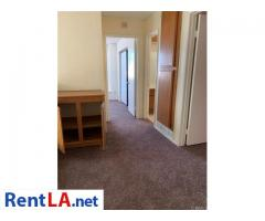 This four bedroom, three bath home - Image 1/12