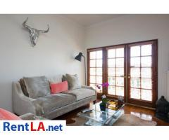 Glam meets rustic-chic in this cozy 1-bdrm fully furnished apartment - Image 2/10